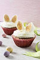 Two Easter bunny cupcakes with marshmallow ears in