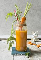 Fresh carrot juice smmothy drink in a jar with bun
