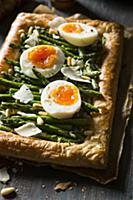 Vegetaraian asparagus tart with boiled eggs, parme