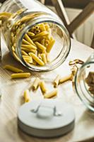 Raw penne pasta in jar