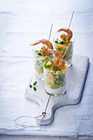 Orange and vegetables salad with prawns in glasses