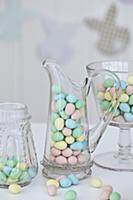 Jars of chocolate Easter egg candy on a table with
