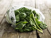 Fresh spinach leaves in a plastic bag