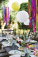 Lanterns above table set in bright colours for Mex