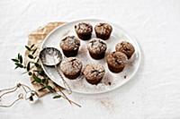 Chocolate muffins with powdered sugar
