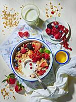 Muesli with milk and summer berries