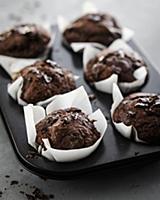 Chocolate muffins in a muffin tin