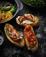 Various types of bruschetta on a wire rack