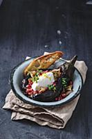 Grilled aubergine with soft cheese and tomato