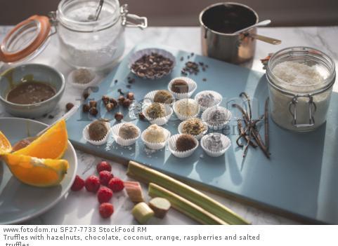 Truffles with hazelnuts, chocolate, coconut, orange, raspberries and salted truffles