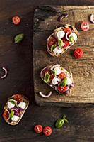 Bruschetta with mozzarella, red onion, strawberry