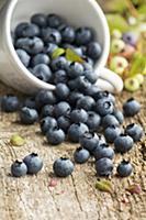 Blueberries in an overturned mug