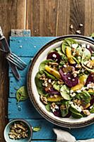 Spinach salad with beets, italian nuts, feta chees