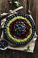 Spinach tart with raspberry jam, blueberries and m