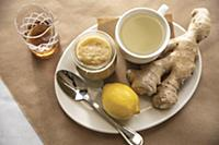 Ginger tea remedy with whole lemon and ginger root