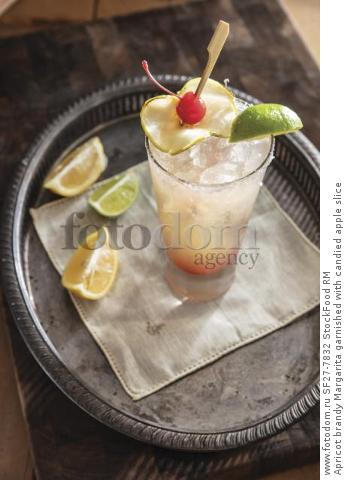 Apricot brandy Margarita garnished with candied apple slice