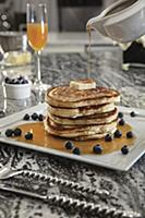 Stack of blueberry buttermilk pancakes with butter