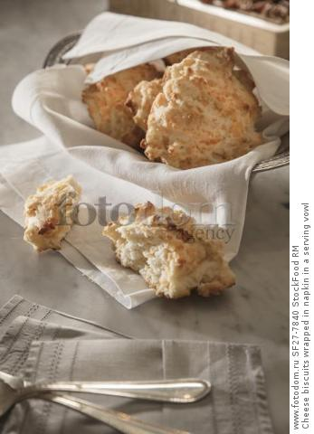 Cheese biscuits wrapped in napkin in a serving vowl