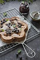 hazelnut giant financier cake with black currants