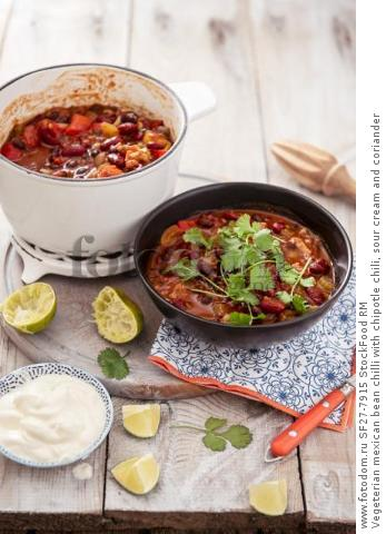Vegeterian mexican bean chilli with chipotle chili, sour cream and coriander