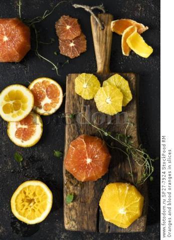 Oranges and blood oranges in slices