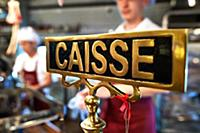 detail of vintage cash register with people at the