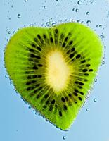 Fresh kiwi slices in water with bubbles