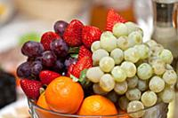 Fresh fruits and berries on the dining table