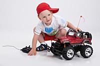 Little boy and remote controlled car