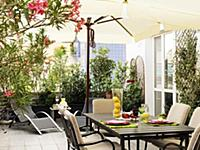 Terrace with table and dishes food between plants