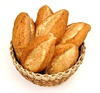 Basket full of breads at the white background