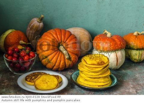 Autumn still life with pumpkins and pumpkin pancakes