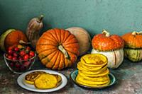 Autumn still life with pumpkins and pumpkin pancak