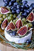 Cheese Camembert with figs, honey, grapes and frag
