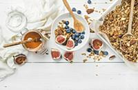 Oat granola with nuts, yogurt, honey, fresh figs a