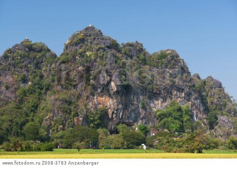 MYANMAR / Kayin State / Hpa-an / Saddar Cave is into this limestone mountain. The capital of Kayin State is surrounded by picturesque karst landscape with paddies.