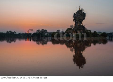 MYANMAR / Kayin State / Hpa-an / Sunset behind Kyauk Ka Lat. Pilgrimage site contains a small monastery and some nat shrines on an island. В© Mario Weigt / Anzenberger