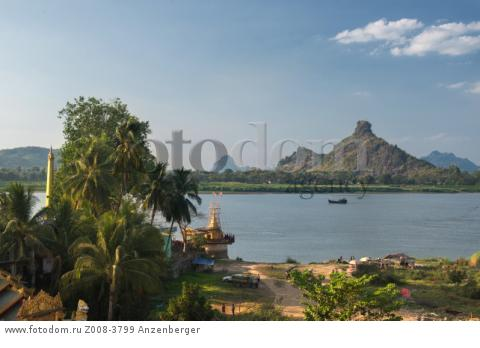 MYANMAR / Kayin State / Hpa-an / Shwe Yin Myaw Pagoda on the bank of the Thanlwin River and the Hpan Pu limestone mountain on the other riversideВ© Mario Weigt / Anzenberger