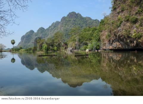 MYANMAR / Kayin State / Hpa-an / Idyllic lake framed by limestone mountains near Saddar Cave