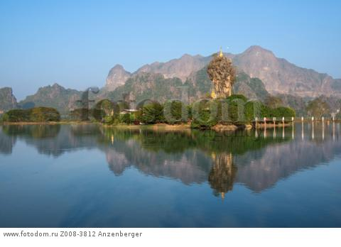 MYANMAR / Kayin State / Hpa-an / Kyauk Ka Lat has a small monastery and some nat shrines and is located on an island. Rugged karst formation with Zwegabin mountain is in the background.
