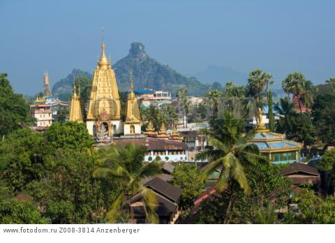 MYANMAR / Kayin State / Hpa-an / Townscape with Ye Kyaung Monastery and Shwe Yin Myaw Pagoda. In the background is the Hpan Pu limestone mountain on the other side of the Thanlwin River