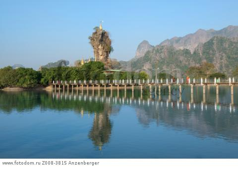MYANMAR / Kayin State / Hpa-an / Kyauk Ka Lat has a small monastery and some nat shrines and is located on an island. Rugged karst formation with Zwegabin mountain is in the background.В© Mario Weigt / Anzenberger