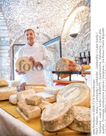 ITALY ( Italien , Italia ) / Lombardy ( Lombardei , Lombardia ) / Lake Garda ( Gardasee , Lago di Garda ) / BIGNOTTI - Gastronomia , Salumeria , Carni alta qualita , Formaggi produzione propria / Gargnano , Via Roma / Paolo Bignotti with his cheese  © Toni Anzenberger / Anzenberger