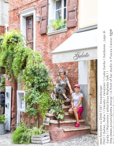 ITALY ( Italien , Italia ) / Veneto ( Venezien ) / Lake Garda ( Gardasee , Lago di Garda ) / Malcesine / artist Enza Miglietta (left ) ( http://www.enzamiglietta.it/eng/ ) in front of her studio in Piazza Cavour 9  © Toni Anzenberger / Anzenberger
