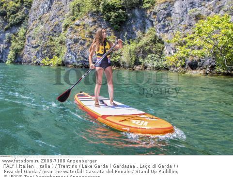 ITALY ( Italien , Italia ) / Trentino / Lake Garda ( Gardasee , Lago di Garda ) / Riva del Garda / near the waterfall Cascata del Ponale / Stand Up Paddling SUP  © Toni Anzenberger / Anzenberger