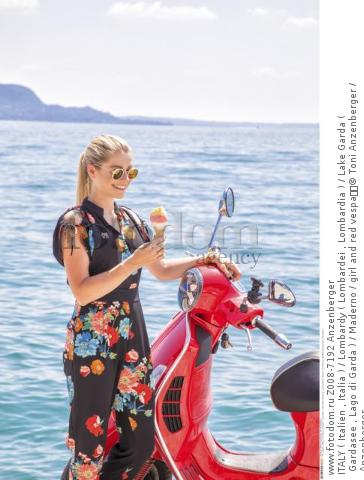 ITALY ( Italien , Italia ) / Lombardy ( Lombardei , Lombardia ) / Lake Garda ( Gardasee , Lago di Garda ) / Maderno / girl and red vespa  © Toni Anzenberger / Anzenberger
