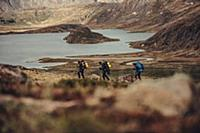 Hiker on a route through greenland, greenland, arc