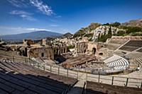 View to the Teatro di Antico of Taormina with Etna