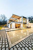 Bauhaus villa at dusk, Sauerland, Germany  Для ком