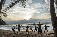 A yoga class on the beach on the island of Koh Pha